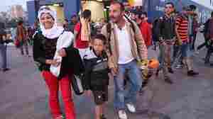 Some 800 migrants from the Middle East arrive at the Greek port of Piraeus on Sunday. Smugglers are char