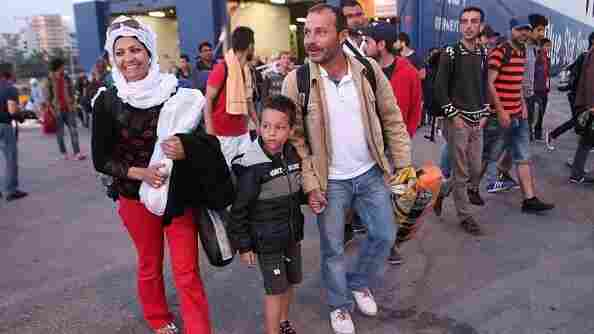Some 800 migrants from the Middle East arrive at the Greek port of Piraeus on Sunday. Smugglers are charging thousands of dollars to take migrants across the Mediterranean, and prices can vary widely. Children are often allowed to travel for free.