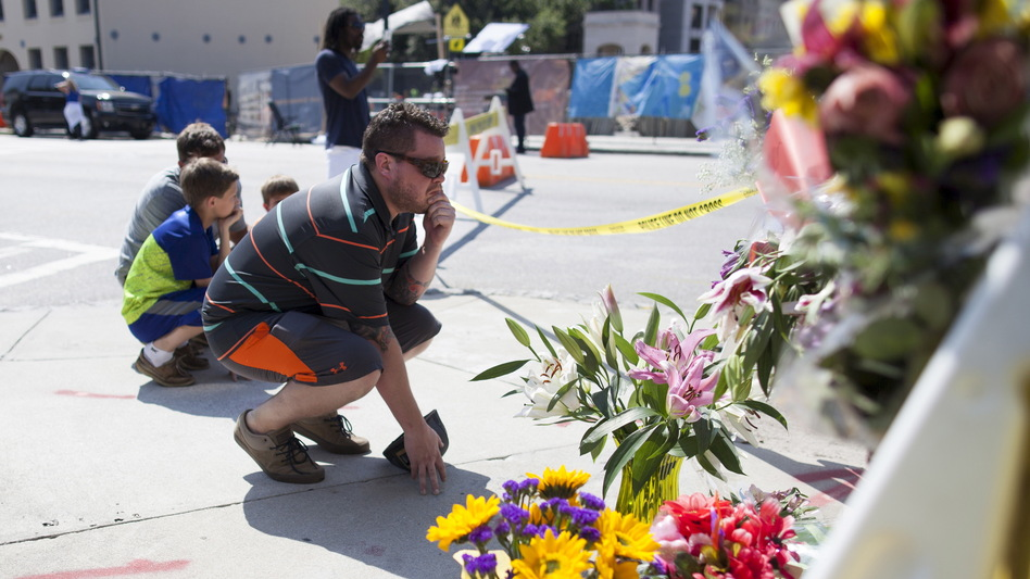 Charleston residents visit a makeshift memorial for victims of Wednesday's mass shooting at the Emanuel AME Church on Calhoun Steet in Charleston, S.C. (Randall Hill/Reuters /Landov)