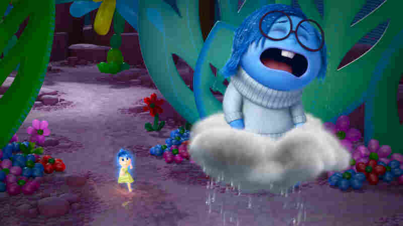 """""""[Sadness is] such a funny opposite energy to Joy, who is literally jumping up and down,"""" Poehler says. """"And Sadness just wants to lie down and kind of feel her feelings."""" Poehler plays Joy (left) and Phyllis Smith plays Sadness in the new film"""