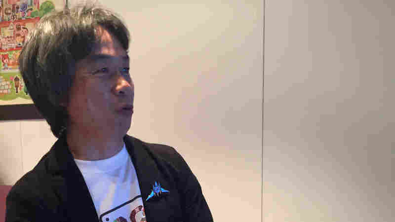 Shigeru Miyamoto plays the latest Mario game, called Super Mario Maker, at the Nintendo booth Wednesday at this year's E3 video game expo in Los Angeles.