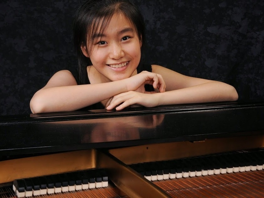Young amateur playing the piano teen
