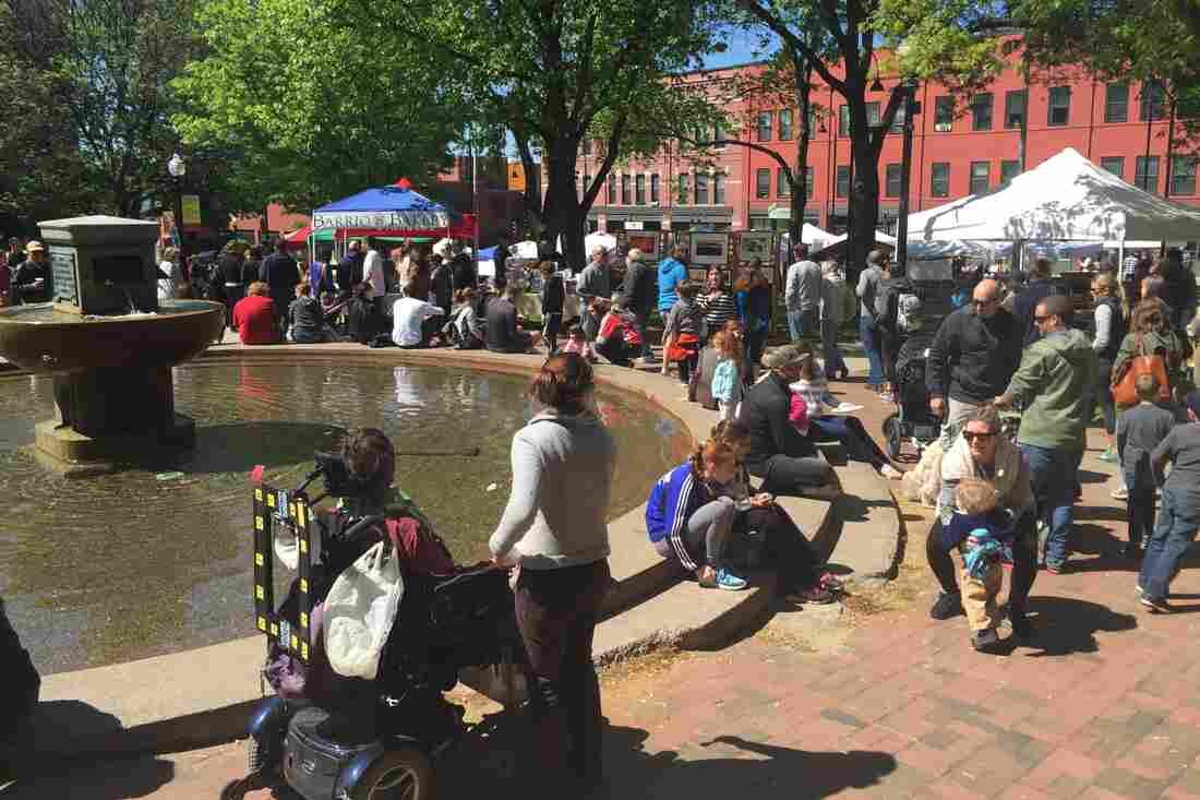 Vermonters crowd a farmers market in downtown Burlington, Vt.