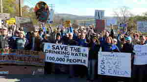 "At an October protest, hundreds of ""We Are Seneca Lake"" members block the gates of Crestwood Midstream to protest against the expansion of fracked gas storage in the Finger Lakes."