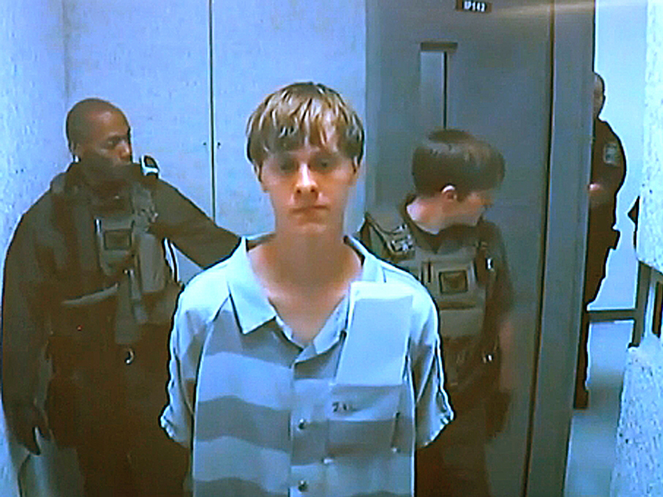 Dylann Roof appears via video before a judge in North Charleston, S.C, today. The 21-year-old man accused of killing nine people inside a black church in Charleston made his first court appearance and bail was set for $1 million on a charge of weapons possession. The judge said he did not have the authority to set bail on the nine counts of murder against Roof. (AP)