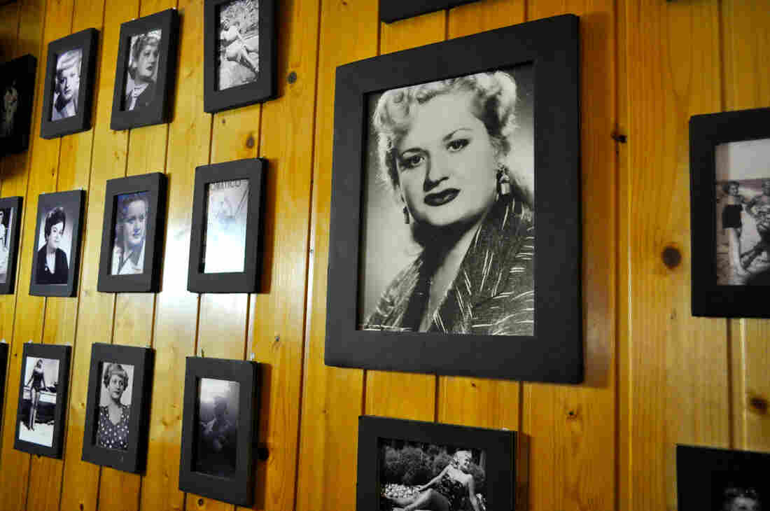 Black and white photos of the Tosca family line the wood-paneled walls of Can Tosca, a traditional Catalan restaurant in Barcelona's Grácia neighborhood.