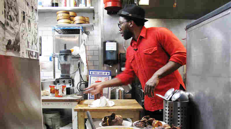 Tunde Wey prepares a pop-up Nigerian dinner in the kitchen of Toki Underground, a ramen restaurant in Washington, D.C., in December 2014.