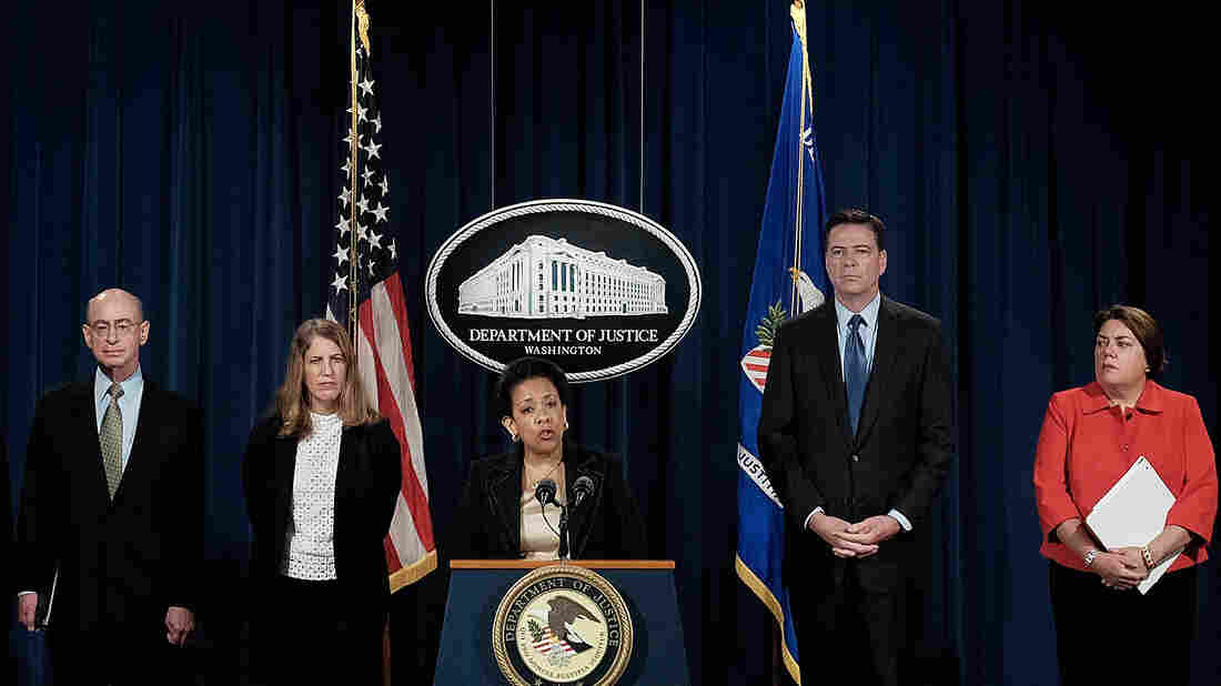 Attorney General Loretta Lynch speaks about a federal crackdown on Medicare fraud. With her are HHS Inspector General Daniel R. Levinson (from left), HHS Secretary Sylvia Mathews Burwell, FBI Director James B. Comey and Assistant Attorney General for the Criminal Division Leslie R. Caldwell.