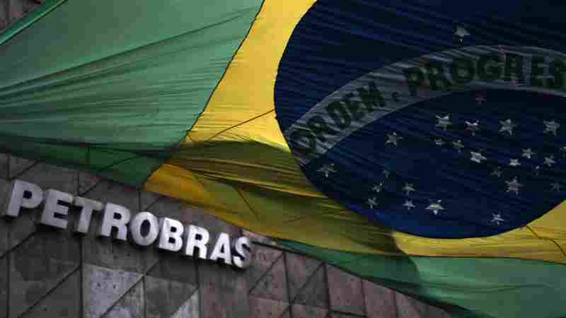 The Brazilian national flag flutters at the front of the headquarters of the Brazilian state oil giant Petrobras, in Rio de Janeiro.