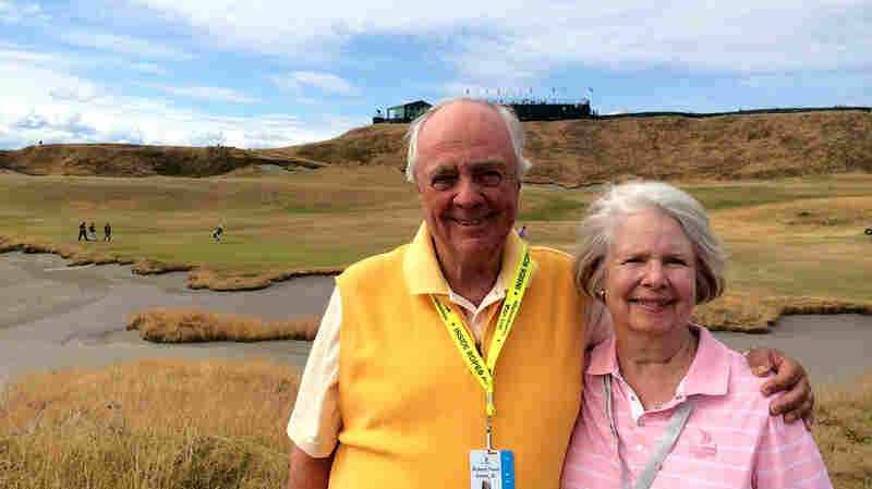Chambers Bay golf course architect Robert Trent Jones, Jr., stands with his wife, Claiborne, next to the 18th fairway.