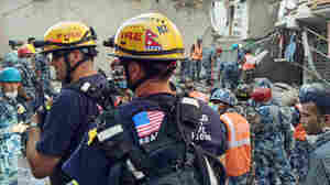 Members of Task Force 2 from the Los Angeles County Fire Department recovered survivors from a building that collapsed in May after a major aftershock in Singati, a mountain village in Nepal.