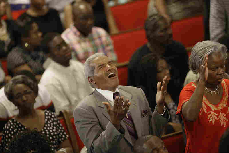 Parishioners sing four days after a mass shooting that claimed the lives of nine people at the historic Emanuel African Methodist Church on Sunday.
