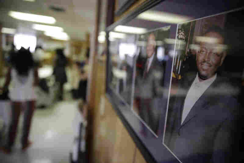 A portrait of the Rev. Clementa Pinckney (right) hangs on a wall at the historic Emanuel African Methodist Church.