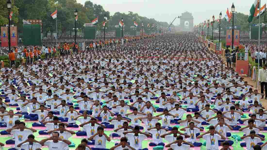 A mass yoga session on Rajpath, New Delhi's ceremonial boulevard, marks International Yoga Day.