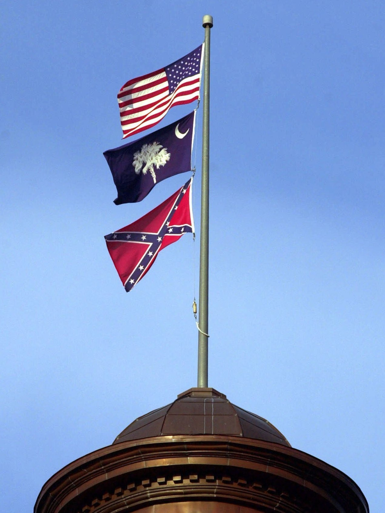 The Confederate Flag Flies On Dome Of Statehouse In Columbia SC 2000 Eric Draper Associated Press Hide Caption