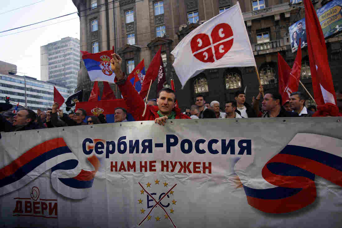 """Serbian protesters hold a banner that reads: """"Serbia-Russia, we don't need the European Commission"""" on March 21 in Belgrade. The marchers were from a Serbian nationalist organization opposed to the government, which has pursued closer ties with Western Europe."""