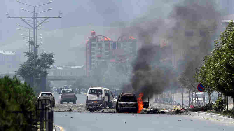 Fire and smoke rise at the site of a suicide attack during clashes with Taliban fighters in front of the Parliament in Kabul, Afghanistan, on Monday.