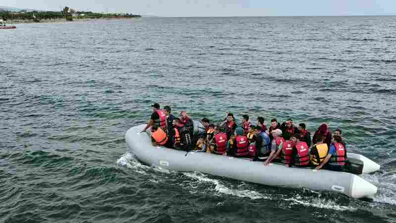Migrants on a dinghy head to the Greek island of Lesvos last Thursday. Some 48,000 migrants have landed on Greek shores so far this year, with about half coming to Lesvos, a popular vacation spot for European tourists. Some islanders and tourists are assisting the migrants, many of whom are camping in the open.