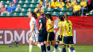 Lauren Holiday of the United States is given a yellow card Monday in the first half against Colombia in a Women's World Cup match in Edmonton, Canada. She also received one in an earlier match against Australia, so Holiday will be suspended for the Americans' next match.