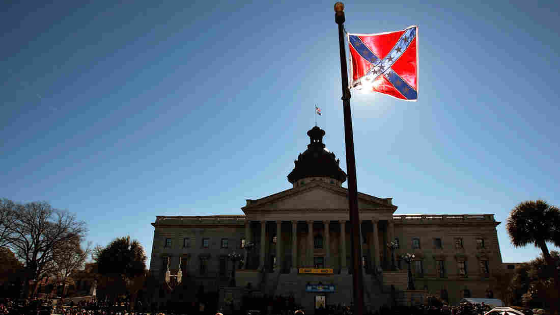 A Confederate flag that's part of a Civil War memorial on the grounds of the South Carolina Statehouse flies during a Martin Luther King Day rally in 2008. The state is under fire for continuing to fly the flag.