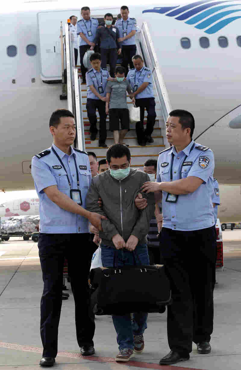 China has launched a major program to arrest suspects who have fled abroad. Six fugitives were brought back from Indonesia to the Capital International Airport in Beijing on Sunday.