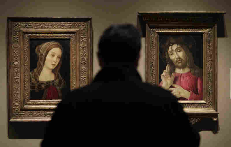 """In 2010 the Detroit Institute of Arts hosted the exhibit """"Fakes, Forgeries, and Mysteries"""" — about how experts figure out whether artworks are authentic. Above, a painting titled A Female Saint (left) that was once attributed to Italian artist Sandro Botticelli is exhibited alongside The Resurrected Christ (right), a Botticelli painting from around 1480."""