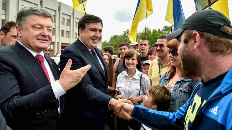 Mikheil Saakashvili (center) is the former president of Georgia, which waged a brief war with Russia in 2008. Last month, Ukrainian President Petro Poroshenko (left) named Saakashvili the governor of Odessa, the port city in Ukraine, a country waging its own battle with Russia. The two are shown in Odessa on May 30.