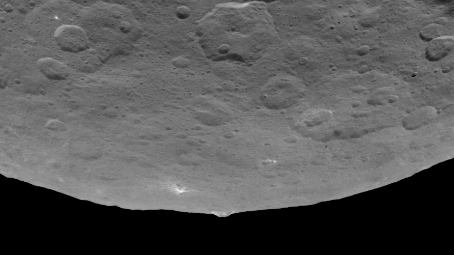 A roughly pyramid-shaped mountain protrudes from a relatively smooth area of Ceres in this image taken by NASA's Dawn spacecraft on June 14.