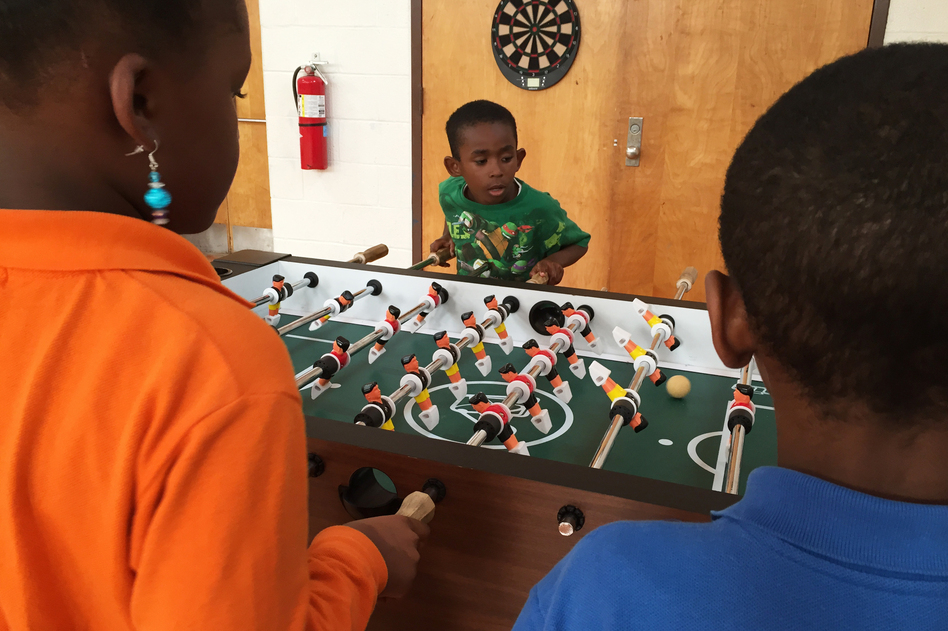 Najuel Gaylord plays foosball at the Lillian S. Jones Recreation Center in West Baltimore's Sandtown neighborhood. Local recreation centers, which have a long tradition in Baltimore, provide a much-needed refuge for children in some of the city's poorest areas. (Jennifer Ludden/NPR)