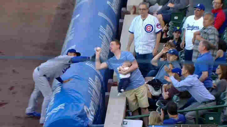 A father who snagged a foul ball at a Chicago Cubs game Tuesday is getting praise — even though the play was overturned.
