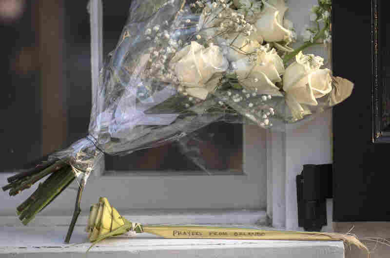 A palm rose with a message from Orlando, Fla., is placed near the front of the Emanuel AME Church just days after the shooting.