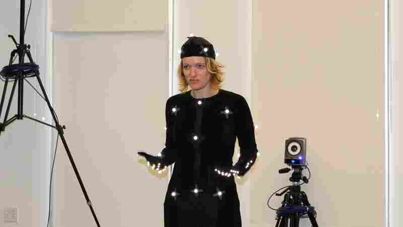 Melissa Malzkuhn, director of the Motion Light Lab at Gallaudet University, suits up in motion capture to record a nursery rhyme for deaf children.