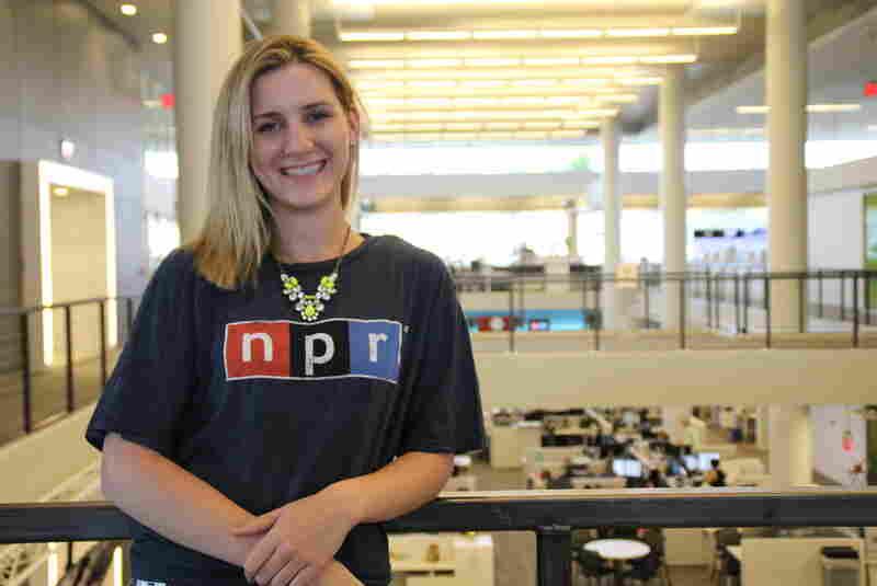 NPR intern dons an NPR t-shirt during a visit to the newsroom.