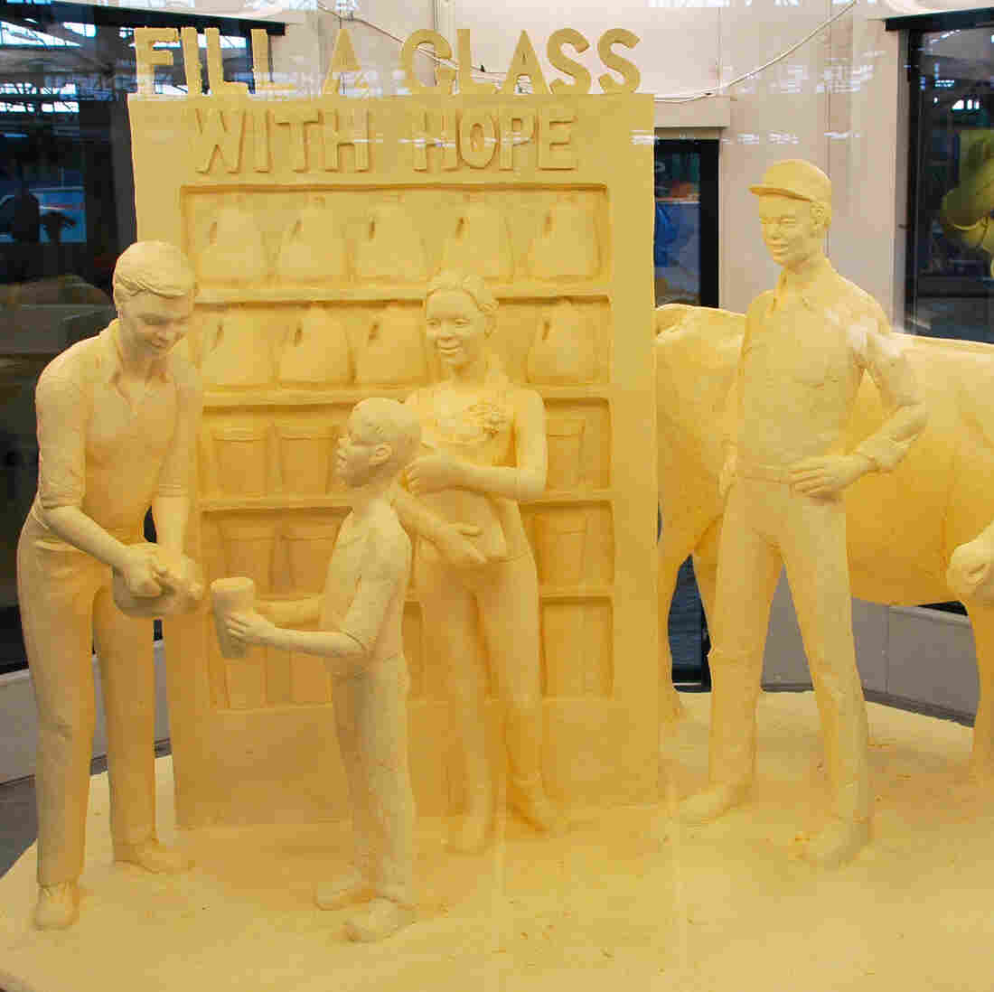 "Art of the people: Fill a glass with hope, a butter sculpture crafted by Jim Victor and Marie Pelton. ""People don't understand how [the sculpting] is done --€"" it's like magic and just appears,"" Victor says. ""But people understand butter."""