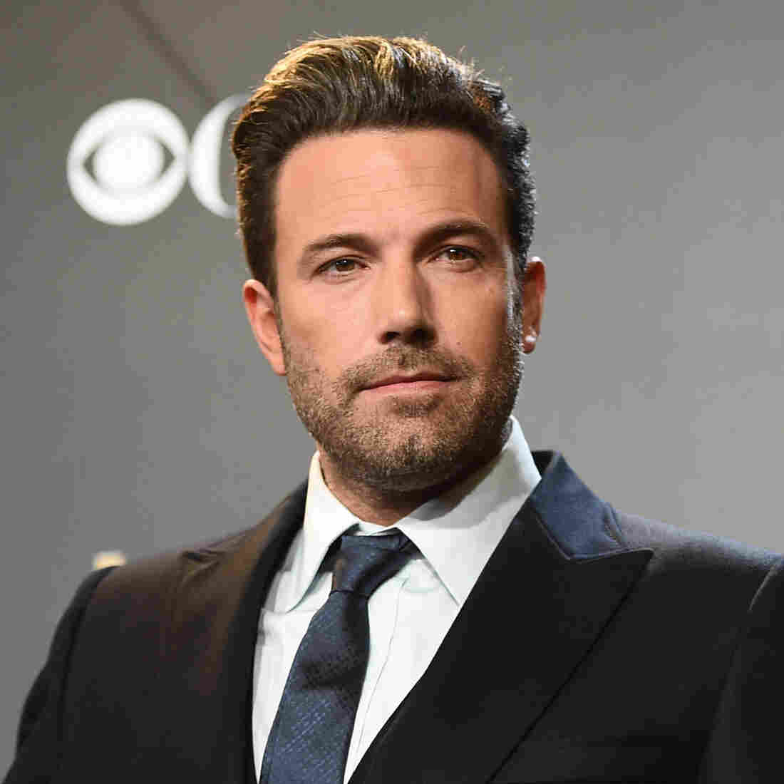 Ben Affleck poses in the press room with the Hollywood film award for Gone Girl at the Hollywood Film Awards in Los Angeles. PBS says it's postponing the third season of Finding Your Roots after an internal investigation of an episode about Affleck's ancestors.