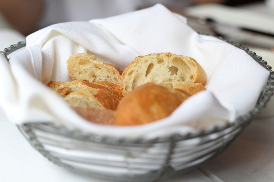 Bite into that bread before your main meal, and you'll spike your blood sugar and amp up your appetite. Waiting until the end of your dinner to nosh on bread can blunt those effects. (iStockphoto)