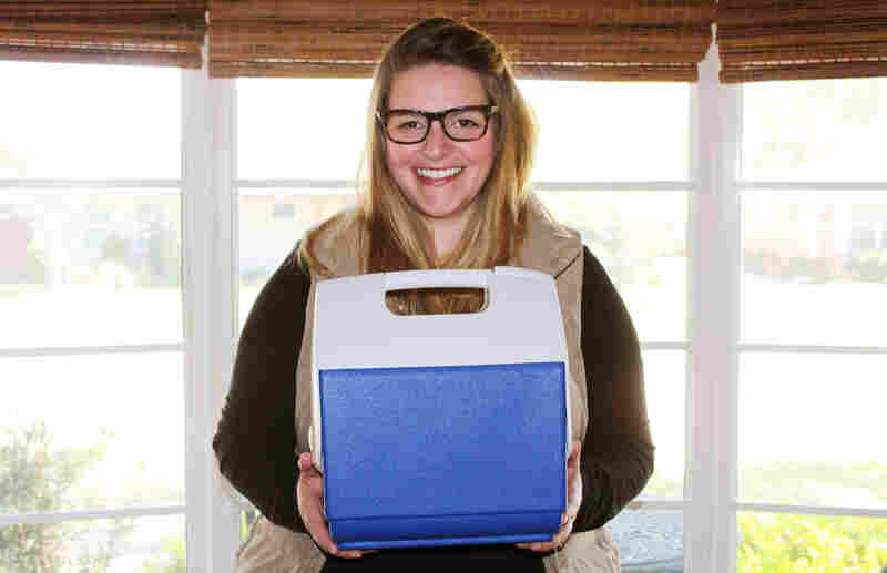 Melissa Mathis holding the cooler she used to smuggle her placenta out of the hospital.