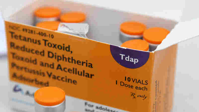A box of vaccine vials sits on a table during a Solano County health fair in 2010 in Vallejo, Calif.