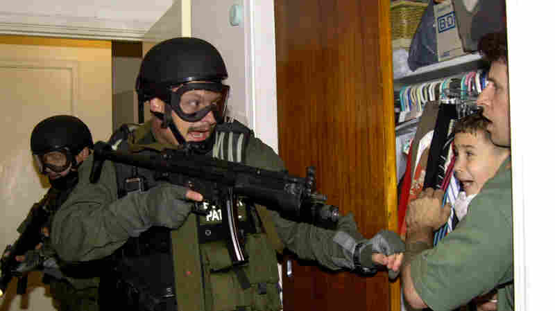 Federal agents seized Elián González, held in a closet by Donato Dalrymple, in Miami in April 2000. Dalrymple rescued the boy from the ocean after his mother drowned when they tried to escape Cuba.