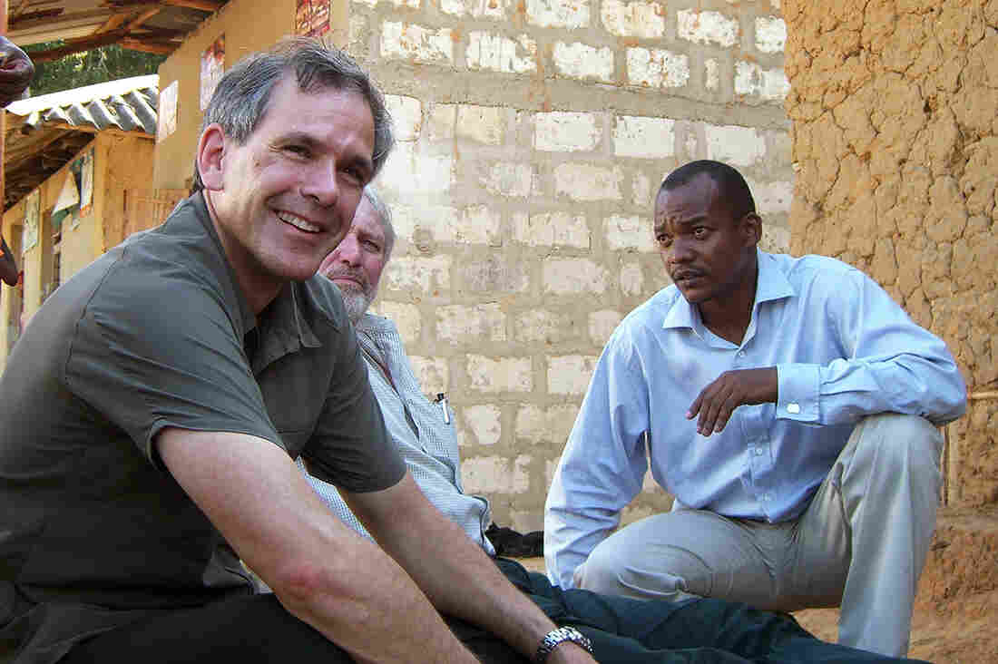Dr. Christopher Murray in Tanzania on his quest to find out causes of death around the world. His chief collaborator Alan Lopez, is seated behind him.