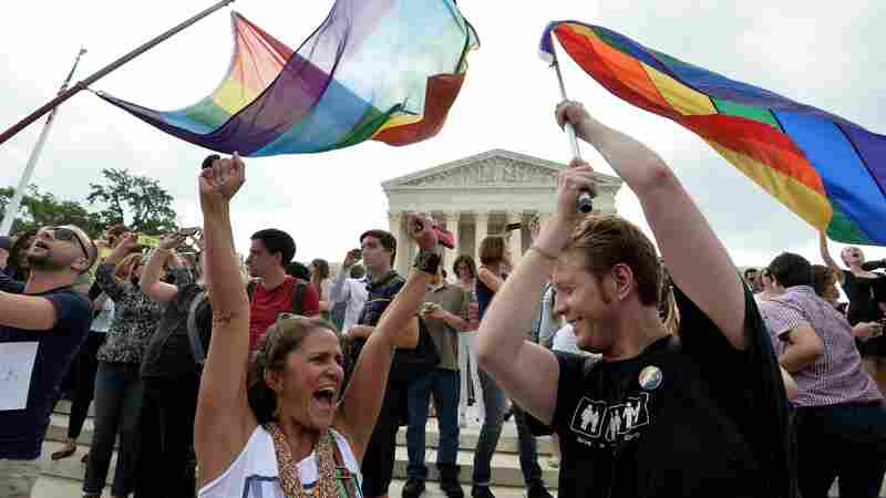 People celebrate outside the Supreme Court in Washington on Friday after its historic 5-4 decision on same-sex marriage.