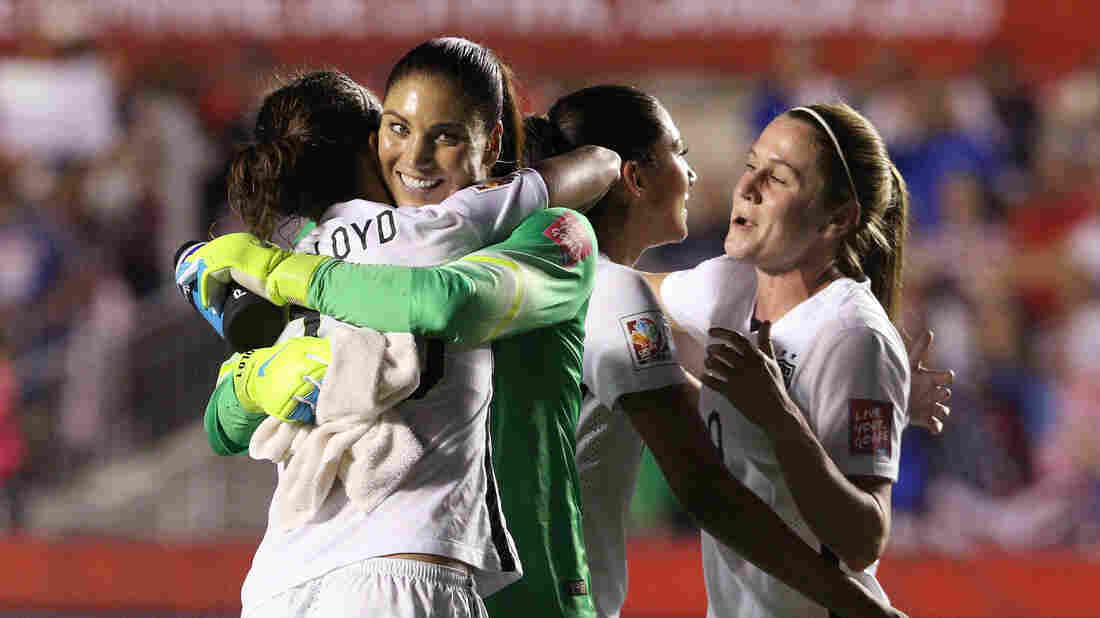 Goalie Hope Solo of the United States celebrates with midfielder Carli Lloyd on Friday after defeating China 1-0 in the Women's World Cup quarterfinals in Ottawa, Canada.