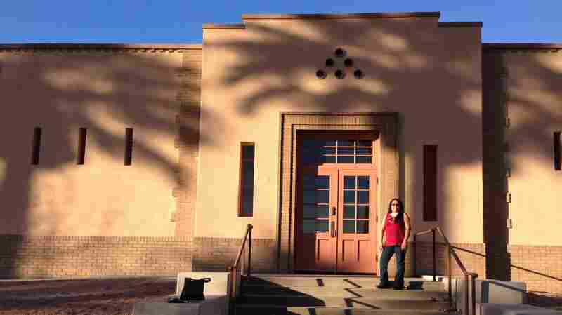 Former band student Rosalee Talahongva in front of her old music building, which is being turned into a Native American cultural center.