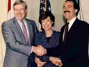In today's show, Carla A. Hills recalls this photograph of a three-way handshake with Canada's Minister Wilson and Mexico's Secretary Serra following the conclusion of NAFTA negotiation.