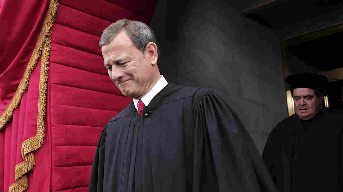U.S. Supreme Court Chief Justice John Roberts, followed by Justice Antonin Scalia, at the U.S. Capitol in Washington, D.C., in 2013