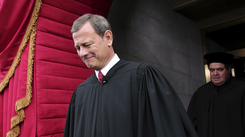 U.S. Supreme Court Chief Justice John Roberts, followed by Justice Antonin Scalia, at the U.S. Capitol in Washington, D.C., in 2013 (Win McNamee/AP)