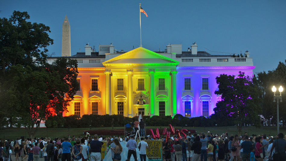 People gathered near the White House on Friday evening to see it lit in rainbow colors as a commemoration of the Supreme Court's ruling to legalize same-sex marriage.