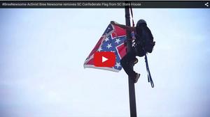 Activist climbing flagpole at South Carolina's Capitol to remove Confederate battle flag.