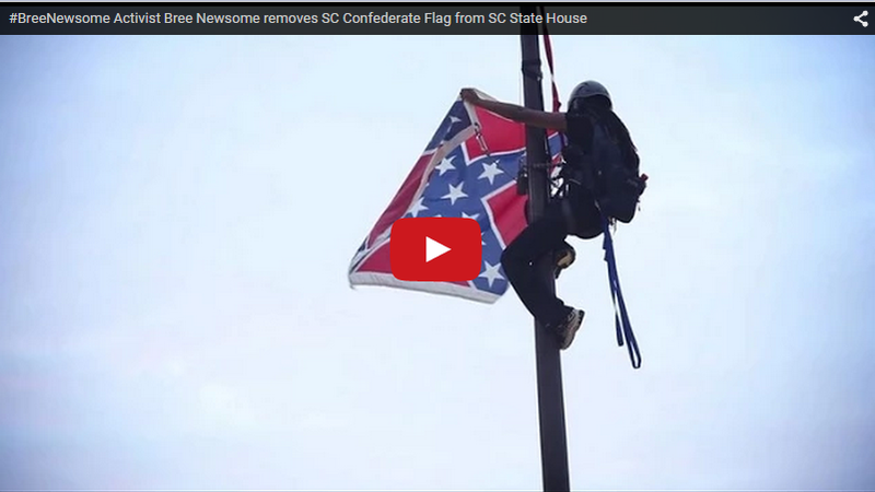 Activist climbing flagpole at South Carolina's Capitol to remove Confederate battle flag.