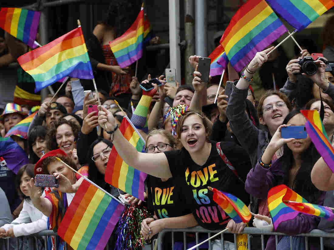 A crowd waves rainbow flags during the Heritage Pride March in New York on Sunday.